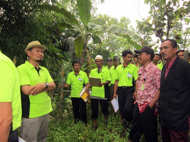 Observation of community forest on the spot, part of field practice of the training.