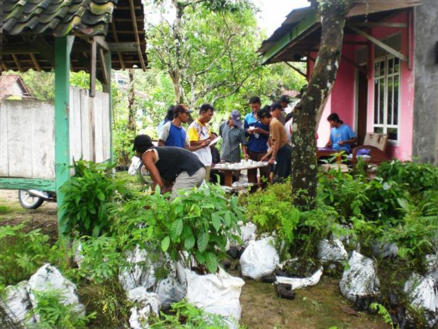 Villagers being registered by T4T staff before receiving various tree species to be planted riverside