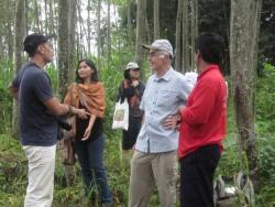 Members of ACIAR research group visit the community forest of Mr. Sunardi (red shirt), a member of the local Farmer Group