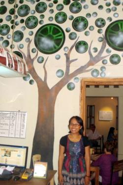 Sri Mujianti , ViaVia manager in front of Trees4Tours logo