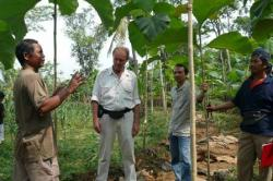 Mr. Melle discussing forest management with farmer